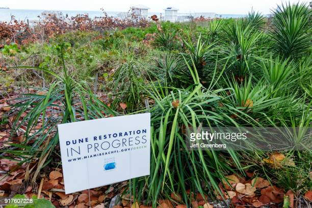 A dune restoration sign at Miami Beach