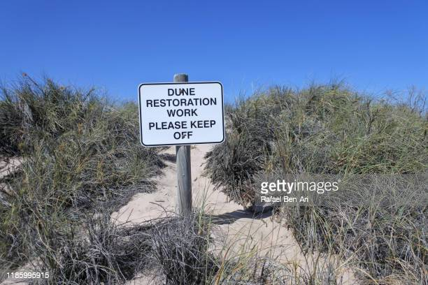 dune restoration work sign in kalbarri western australia - rafael ben ari stock pictures, royalty-free photos & images