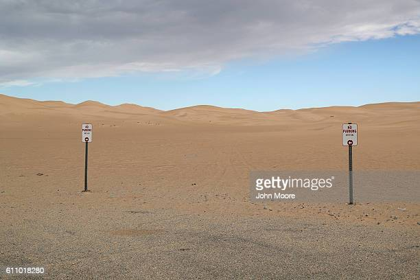 Dunes stretch into the distance near the USMexico border on September 27 2016 in the Imperial Sand Dunes recreation area California The border...