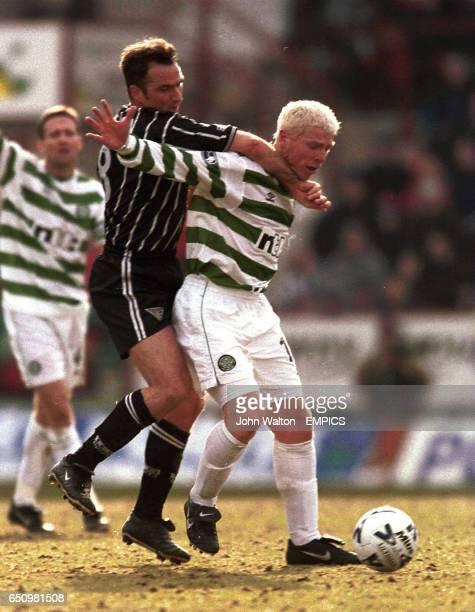 LR Dunfermline Athletic's Ian Ferguson battles for possession of the ball with Celtic's Neil Lennon