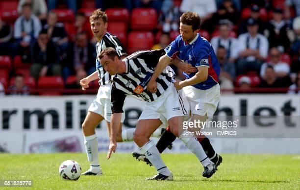 Dunfermline's Ian Ferguson battles for possession of the ball with Rangers' Neil McCann