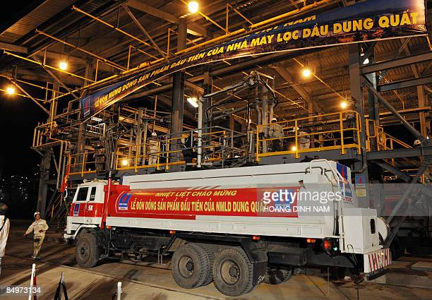Dung Quat oil refinery workers pump its first stream of commercial product into an oil tanker truck during the inauguration ceremony of the Dung Quat...