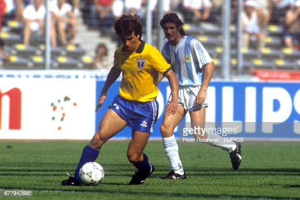 Dunga in action for Brazil watched by Argentina's Claudio Caniggia