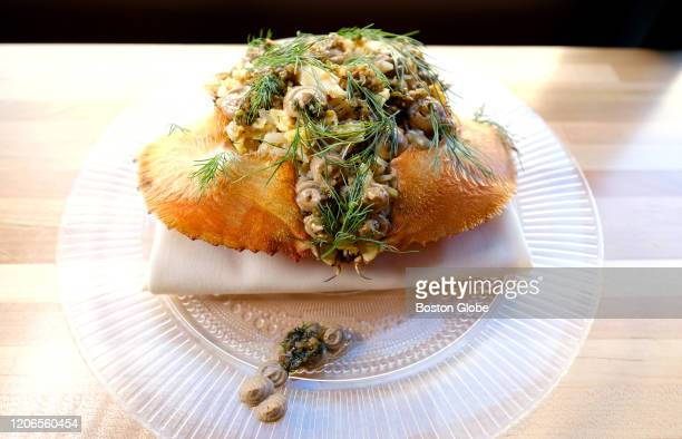 """Dungeness, """"crab fried rice,"""" with ginger scallion vinaigrette and black garlic at Nightshade Noodle Bar in Lynn, MA is pictured on Feb. 27, 2020."""