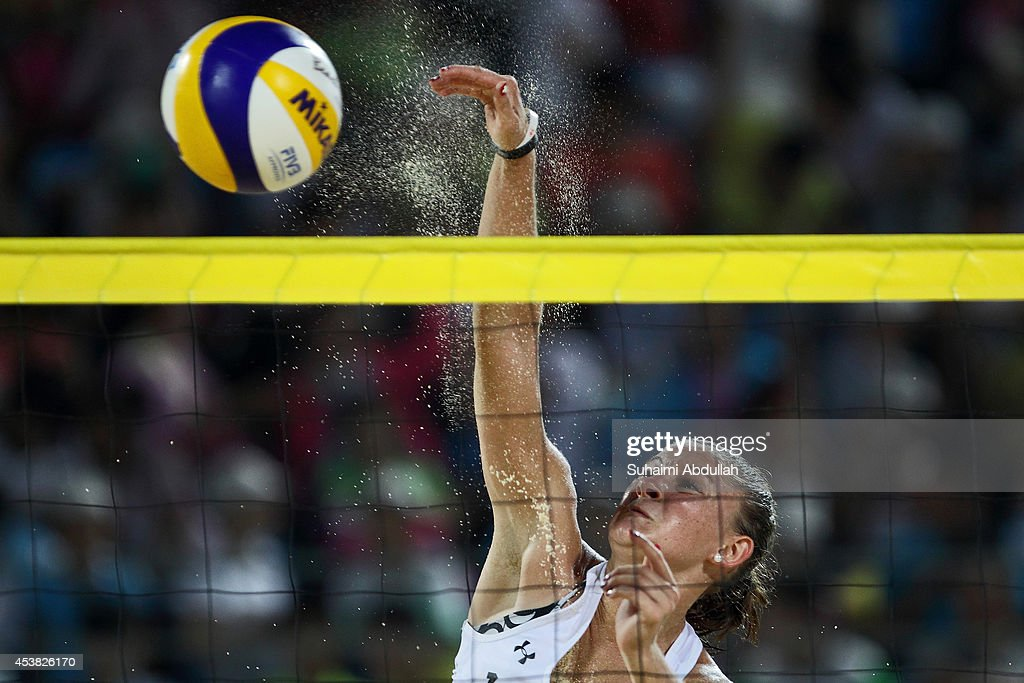 Dunja Gerson of Switzerland spikes the ball against United States during the Nanjing 2014 Youth Olympic Beach Volleyball at the Olympic Sports Park on August 19, 2014 in Nanjing, China.