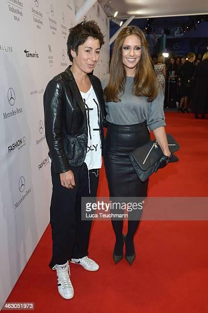 Dunja Hayali and Nazan Eckes arrive for the Guido Maria Kretschmer Show during MercedesBenz Fashion Week Autumn/Winter 2014/15 at Brandenburg Gate on...