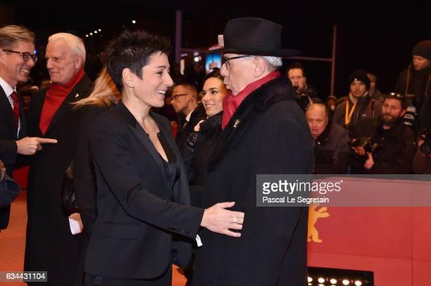 Dunja Hayali greets Festival Director Dieter Kosslick at the 'Django' premiere during the 67th Berlinale International Film Festival Berlin at...