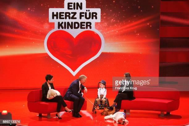 Dunja Hayali Johannes B Kerner Robin Kreidler and Tatjana Kreidler during the Ein Herz Fuer Kinder Gala show at Studio Berlin Adlershof on December 9...
