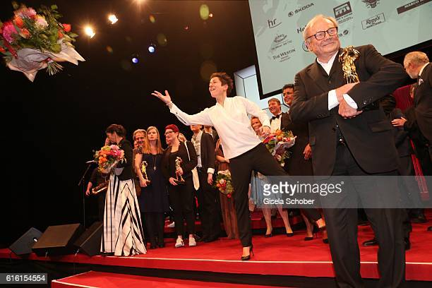 Dunja Hayali trows flowers during the Hessian Film and Cinema Award at Alte Oper on October 21, 2016 in Frankfurt am Main, Germany.