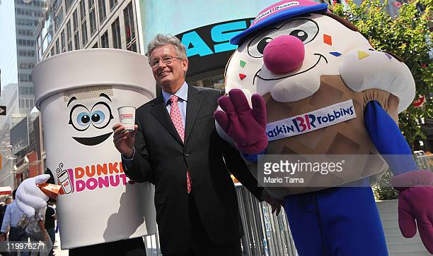 Dunkin' Brands Group President and CEO Nigel Travis, the parent company of Dunkin' Donuts and Baskin-Robbins, celebrates their initial public...