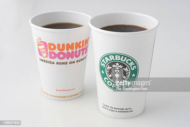 Dunkin' Donuts and Starbucks coffee cups. Photographed in the Washington Post Studio on September 6 in Washington, DC.