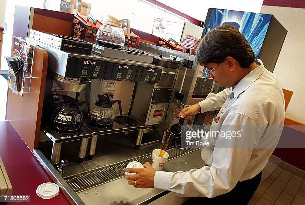 Dunkin' Donuts franchisee store owner Urmil Bhatt pours a customer's cup of coffee September 7, 2006 in Chicago, Illinois. In an effort to compete...