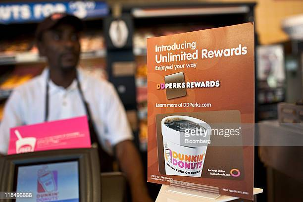 A Dunkin' Donuts Inc rewards card is advertised at a store in West Orange New Jersey US on Thursday July 7 2011 Sales at US retailers surpassed...