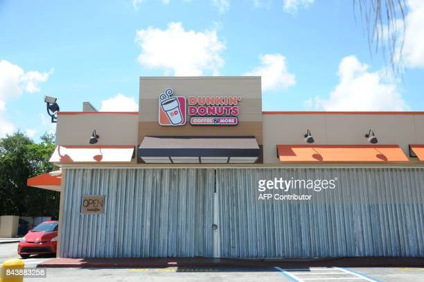 A Dunkin' Donuts shop is boarded as preparations are underway for the arrival of Hurricane Irma September 7 2017 in Fort Lauderdale Florida Hurricane...