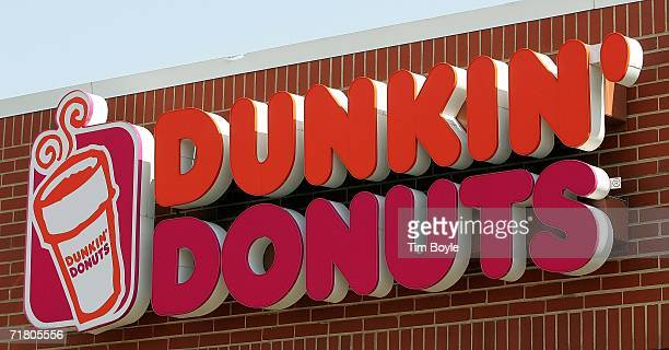 Dunkin' Donuts sign hangs outside one of its stores September 7 2006 in Chicago Illinois In an effort to compete with Starbucks in the lucrative...