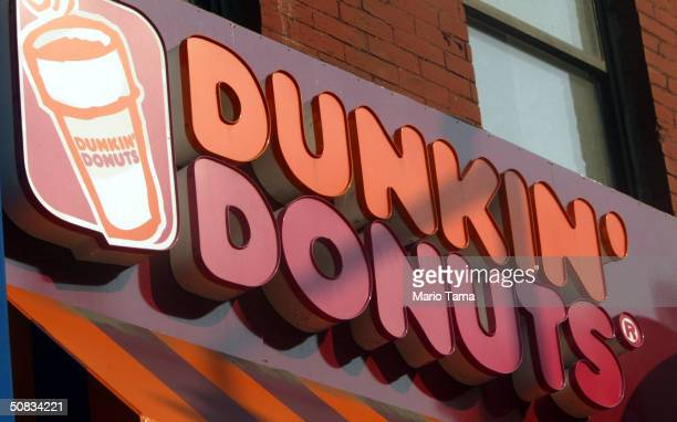 Dunkin Donuts sign is seen May 13 2004 in New York City Dunkin Donuts plans to open 10 stores inside WalMart stores within the next three months