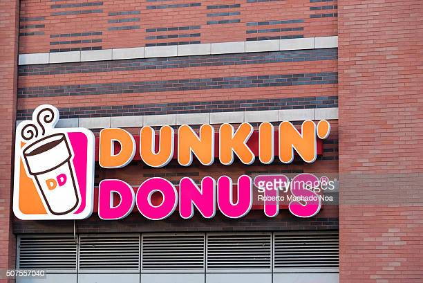 Dunkin' Donuts sign or logo outside restaurant Dunkin' Donuts is an American global doughnut company and coffee house chain It was founded in 1950 by...