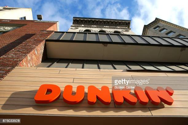 Dunkin' sign is pictured at a new Dunkin' Donuts location on Tremont Street in Boston on Nov 15 2017 Dunkin Donuts is shortening its name on some...