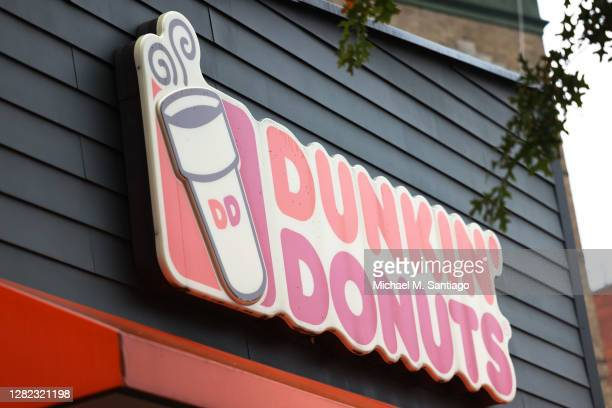 Dunkin' storefront sign is seen on October 26 2020 in New York City The Dunkin' Brands the parent company of the Dunkin' and Baskin Robbins chains is...