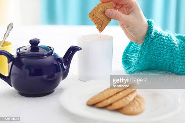 dunking - biscuit stock photos and pictures