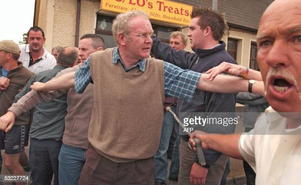 Sinn Fein's Chief Negotiator Martin McGuinness tries to calm people as the Police remove protesters 12 July 2005 in Dunloy Northern Ireland Dunloy...