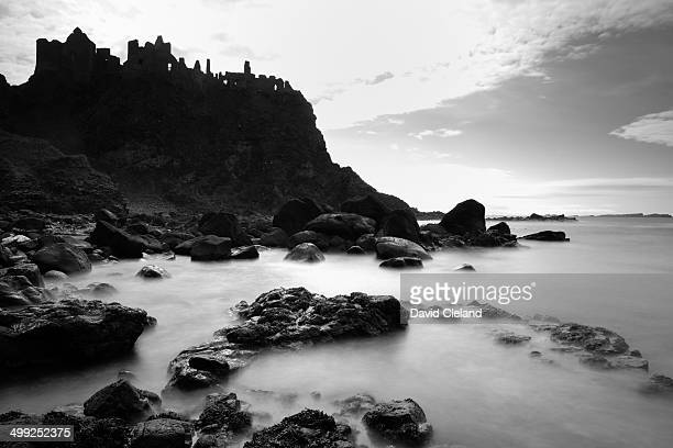 Dunluce castle county antrim black and white long exposure image.
