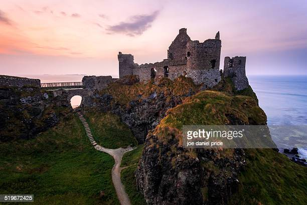 dunluce castle, county antrim, northern ireland - county antrim stock pictures, royalty-free photos & images