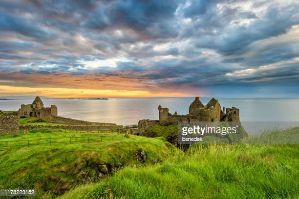 dunluce castle in northern ireland uk - dunluce castle stock photos and pictures