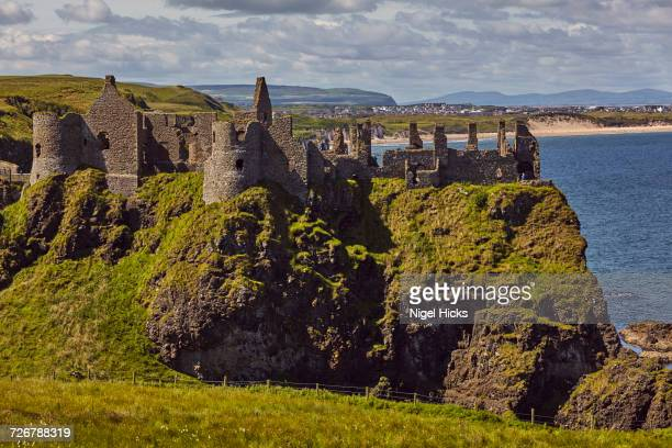 dunluce castle, near portrush, county antrim, ulster, northern ireland, united kingdom, europe - dunluce castle stock photos and pictures
