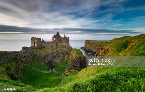 dunluce castle - northern ireland - county antrim stock pictures, royalty-free photos & images
