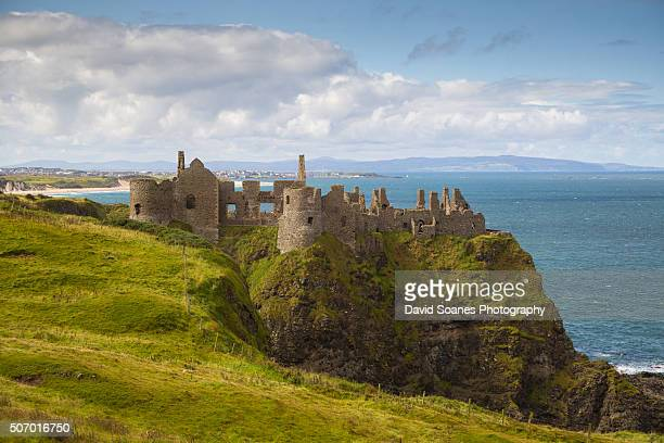 dunluce castle on the causeway coastal route, antrim, northern ireland - dunluce castle stock photos and pictures