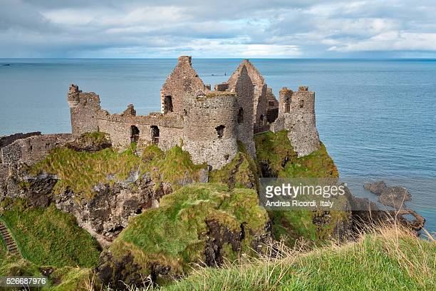 dunluce castle ruins, county antrim, northern ireland - dunluce castle stock photos and pictures