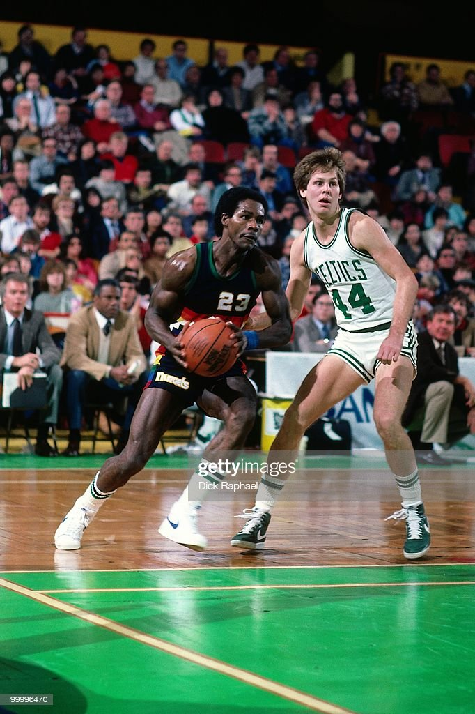T.R. Dunn #23 of the Denver Nuggets makes a move to the basket against Danny Ainge #44 of the Boston Celtics during a game played in 1983 at the Boston Garden in Boston, Massachusetts.