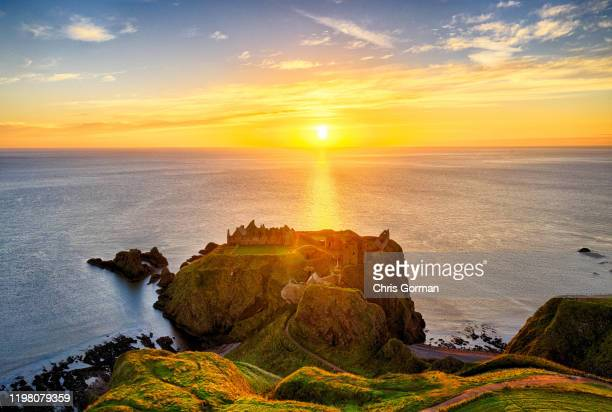 Dunnottar Castle at Sunrise on October 18, 2018 in Dunnottar, Scotland. The Castle is a ruined medieval fortress located upon a rocky headland on the...