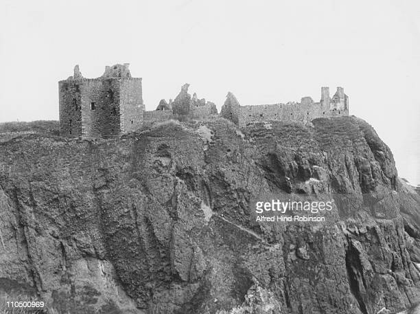 Dunnottar Castle, Kincardineshire, Scotland, on a rock rising 160 feet above the sea, circa 1910. Once it was used as a State prison for the...