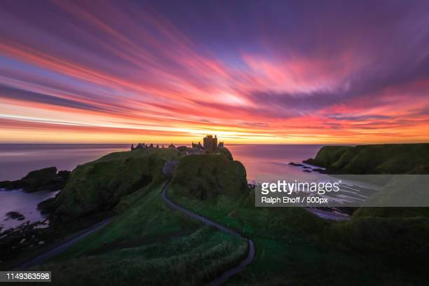 dunnottar castle pre dawn lightshow - dunnottar castle stock pictures, royalty-free photos & images