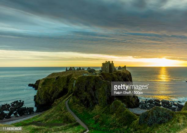 dunnottar castle sunrise - aberdeen scotland stock pictures, royalty-free photos & images