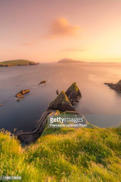 dunquin pier and blasket islands in the background, ireland. - ireland stock pictures, royalty-free photos & images