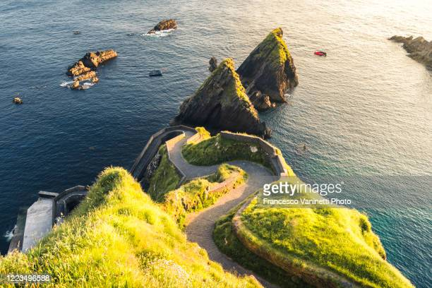 dunquin pier, ireland. - curve stock pictures, royalty-free photos & images