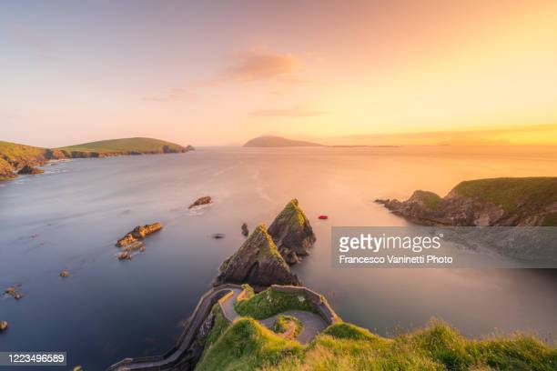 dunquin pier, ireland. - cliff stock pictures, royalty-free photos & images