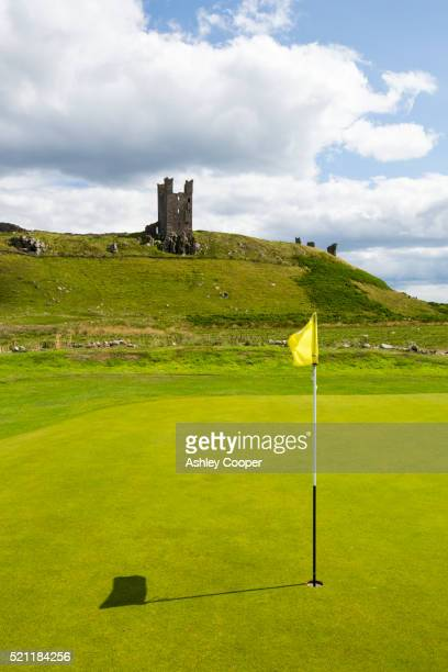 Dunstanburgh Castle and golf course near Craster in Northumberland, UK.