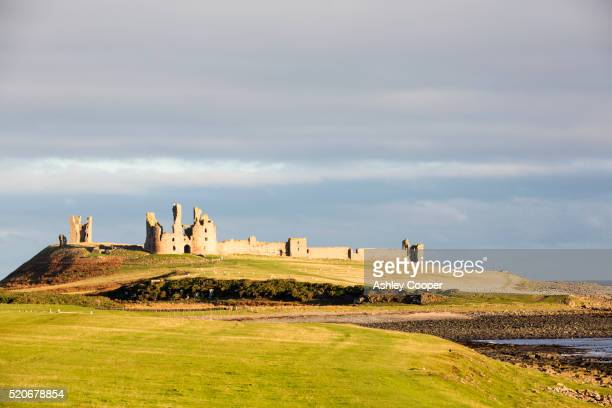 Dunstanburgh castle on Northumberlands coast near Craster.