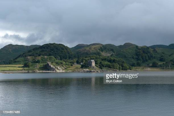 Duntrune Castle on the banks of Loch Crinan on August 19, 2021 in Crinan, Scotland. Passage along the canal has been reduced as water levels run low...