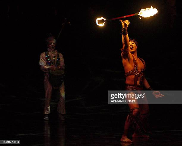 Duo Fire perform during the dress rehearsal of Cirque Du Soleil's Alegria at The Royal Albert Hall in London 04 January 2007 The show which opens...