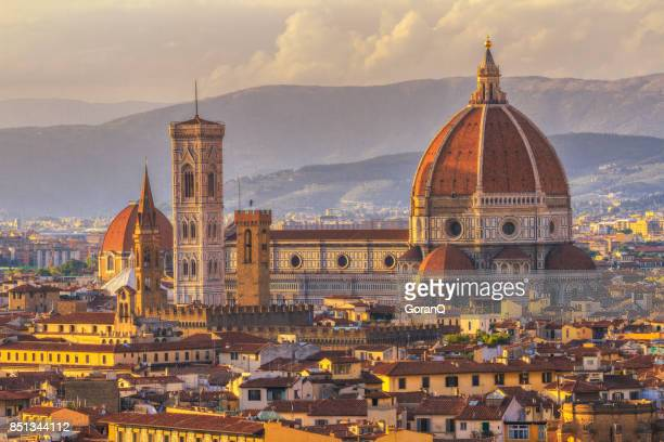 duomo and giotto's campanile at sunset florence, italy - unesco stock pictures, royalty-free photos & images