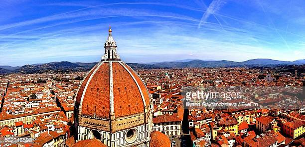 Duomo Santa Maria Del Fiore And Houses Against Blue Sky