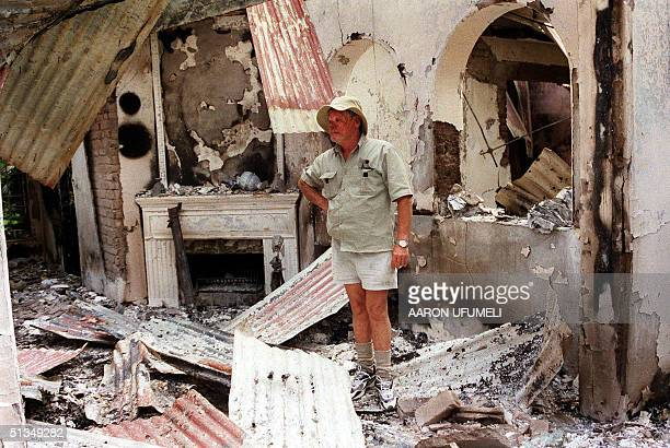 Dup Muller a commercial farmer in Headlands 110 kilometers East of Harare shows his 17th century clock 11 August 2002 that was destroyed when his...