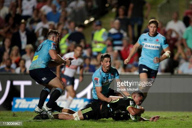 Du'Plessis Kirifi of the Hurricanes scores a try during the round one Super Rugby match between the Waratahs and the Hurricanes at Brookvale Oval on...