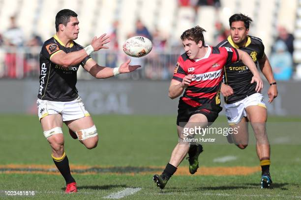 Du'Plessis Kirifi of Wellington looks to pass from Brett Cameron of Canterbury during the round two Mitre 10 Cup match between Canterbury and...