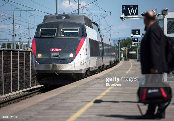 A TGV duplex highspeed train operated by Societe Nationale des Chemins de Fer and manufactured by Alstom SA approaches the railway platform at Gare...